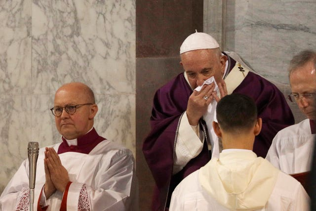 Pope Francis wipes his nose during the Ash Wednesday Mass