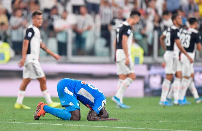 Napoli's Kalidou Koulibaly scored an added time own goal to give Juventus a 4-3 win in Turin - after Napoli had fought back from 3-0 down