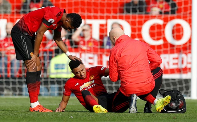 Jesse Lingard is comforted by team-mate Marcus Rashford before becoming the third Manchester United player to be taken off injured in the first half against Liverpool