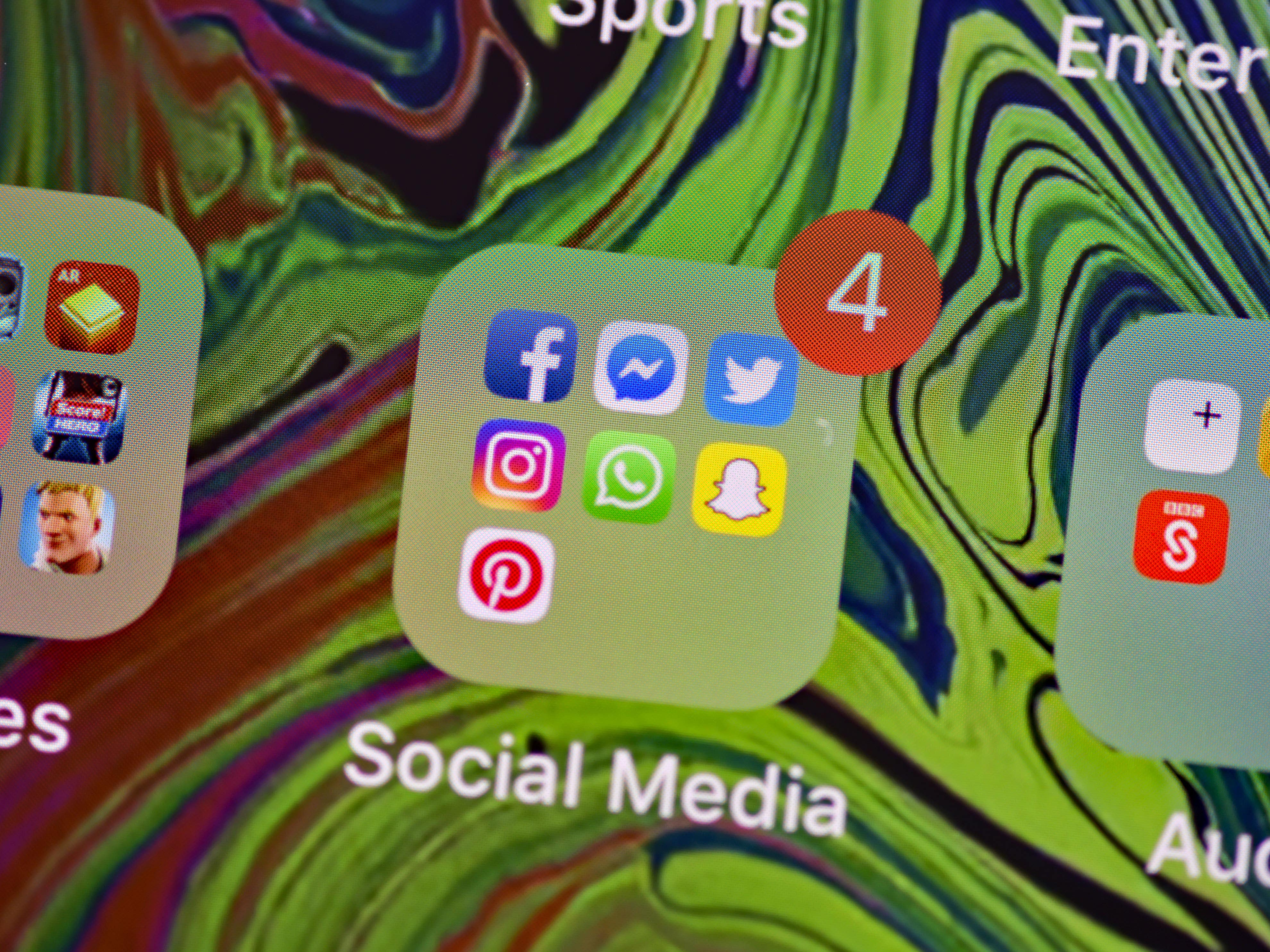 A picture of a mobile phone with social media apps