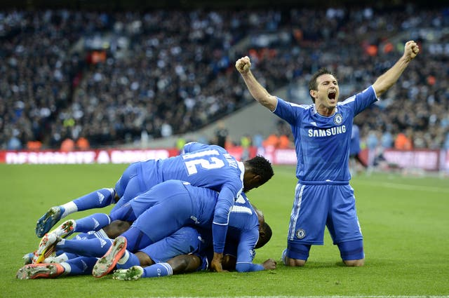 Lampard celebrates a Chelsea goal alongside his team-mates in the FA Cup semi-final win over Tottenham in 2012
