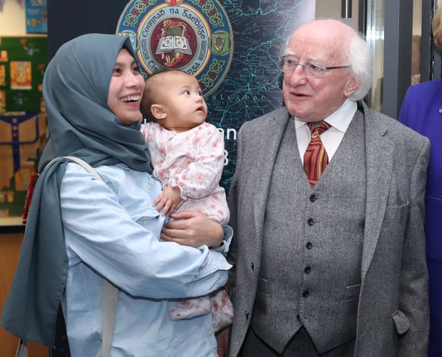 Michael D Higgins donates books to library