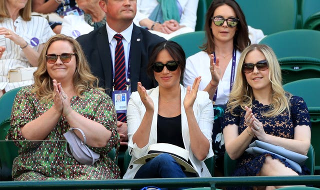 Meghan watching Serena Williams at Wimbledon with Genevieve Hillis, left, and Lindsay Roth