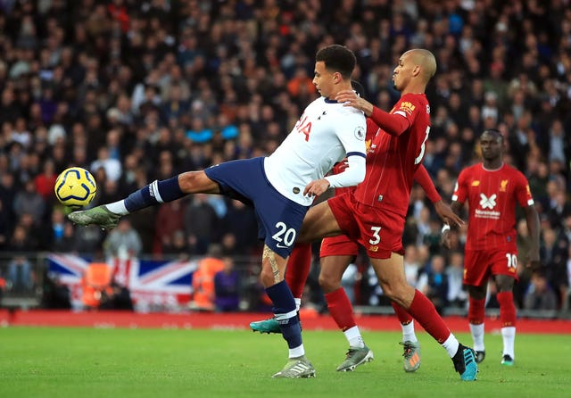 Dele Alli, left, was criticised for his performance at Liverpool
