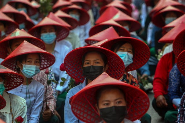 Teachers in their uniform and traditional hats participate in a demonstration in Mandalay