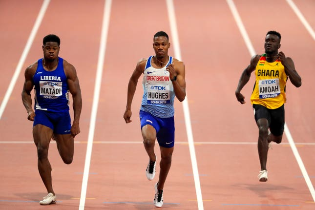 Zharnel Hughes (centre) powers to victory in his 100m heat