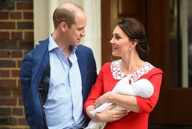 One of the family highlights of the year for the Queen was the birth of her great grandson Prince Louis, pictured here with his parents the Duke and Duchess of Cambridge. Kirsty O'Connor/PA Wire