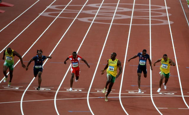 Jamaica's Usain Bolt celebrates at the 2008 Olympic Games after the 100m final