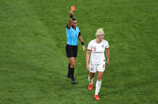 Millie Bright is shown a red card by referee Edina Alves Batista