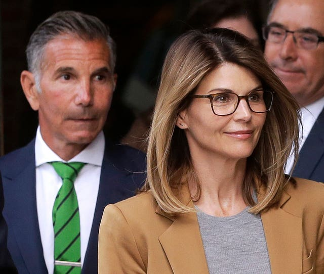 Actress Lori Loughlin and her husband, clothing designer Mossimo Giannulli