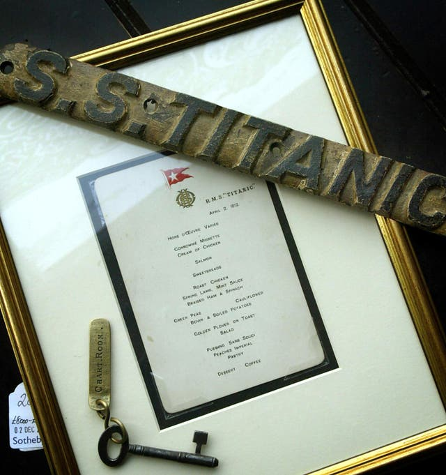 A crew menu card and lifebelt name plate recovered from the wreck of the Titanic