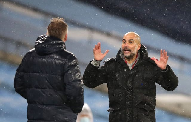 Pep Guardiola (right) believes Manchester City are showing title credentials once again