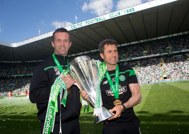 Former Celtic manager Ronny Deila (left) and assistant John Collins with the Scottish Premiership trophy
