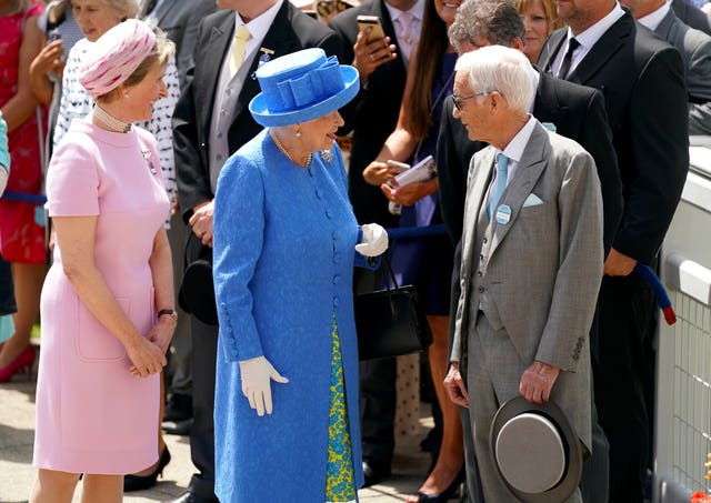 The Queen meets Lester Piggott after unveiling a statue of him in 2019