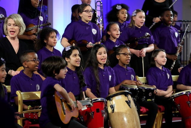 A school choir performs as the Duchess of Cambridge hosts a gala dinner at Buckingham Palace