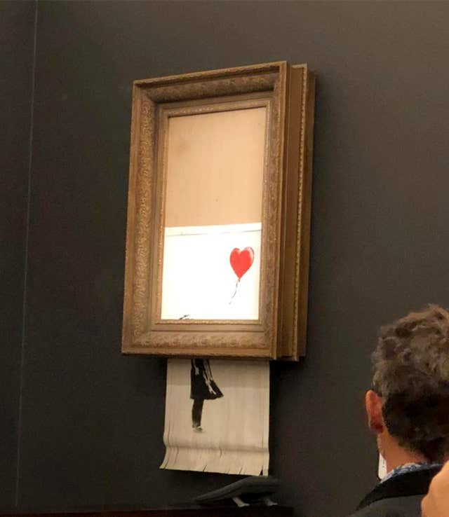 Banksy's artwork, Girl With Balloon, which shredded itself after being sold for more than £1 million at auction