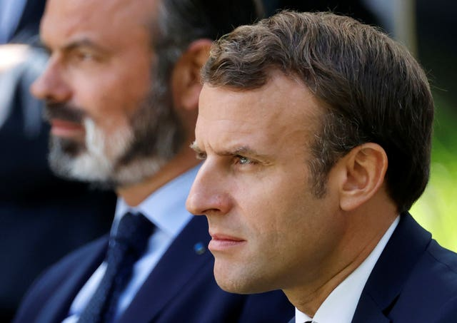 French President Emmanuel Macron, right, and outgoing French prime minister Edouard Philippe (Christian Hartmann/AP)