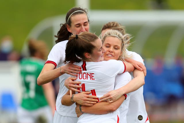 Ella Toone of England celebrates with team-mates Jill Scott and Rachel Daly