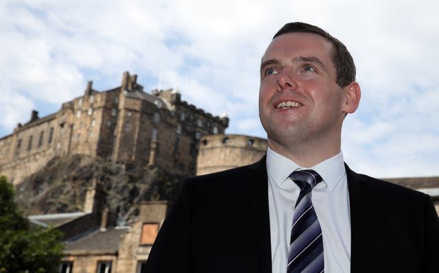 Douglas Ross with Edinburgh Castle in the background
