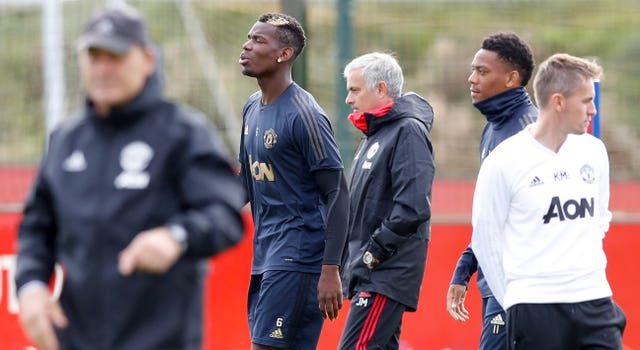 Manchester United's Paul Pogba (left) and former manager Jose Mourinho during a training session. (PA)