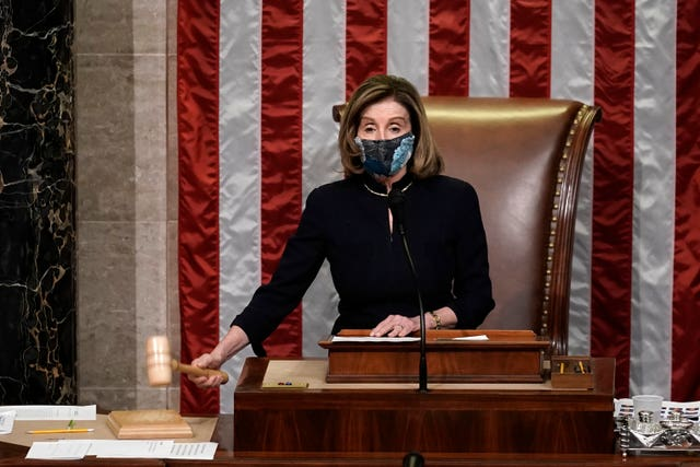 Speaker of the House Nancy Pelosi gavels in the final vote of the impeachment