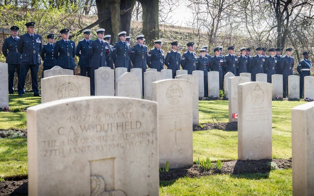 Officers and airmen of the Royal Air Force parade at the Old Garrison Cemetery in Poznan, Poland, where a service of remembrance has been held for the 48 members of the Great Escape buried there