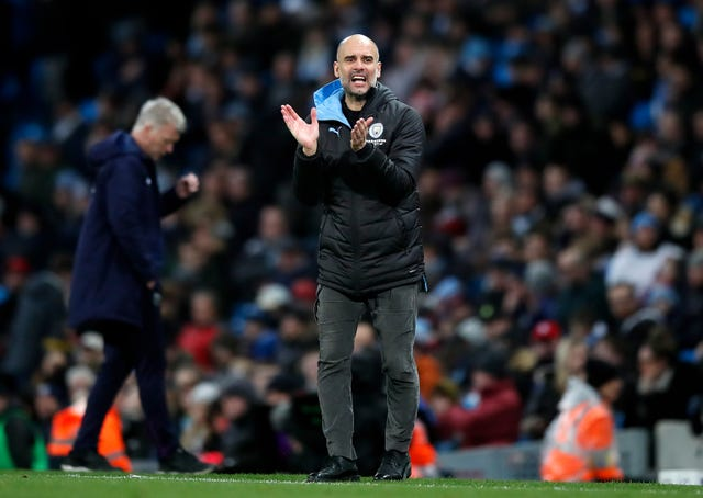 Manchester City manager Pep Guardiola encourages his team