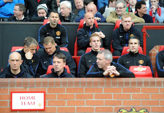 Paul Scholes, back right, was part of manchester United caretaker manager Ryan Giggs' coaching staff in 2014