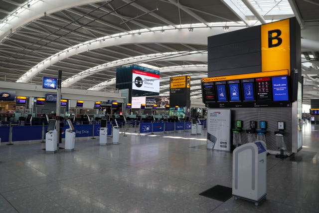 Empty check in desks at Heathrow Terminal 5