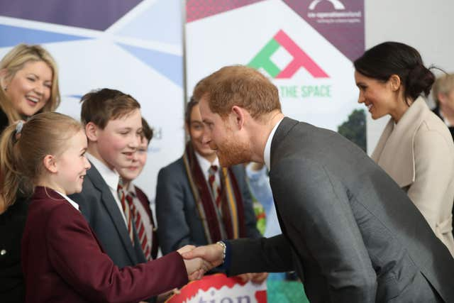 Pleased to meet you - Harry greets young fans at the Eikon Exhibition Centre in Lisburn (Niall Carson/PA)