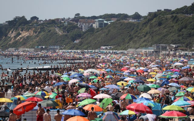 Crowds gather on the beach in Bournemouth on Thursday