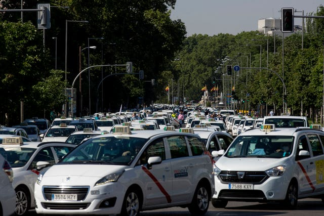 Taxi drivers block a main avenue during a taxi driver protest in Madrid (Manu Fernandez/AP)
