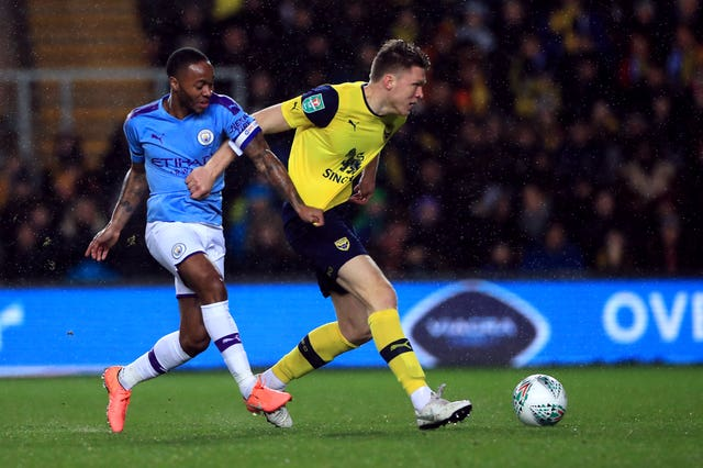 Oxford's Robert Dickie takes on Manchester City's Raheem Sterling in the Carabao Cup quarter-final