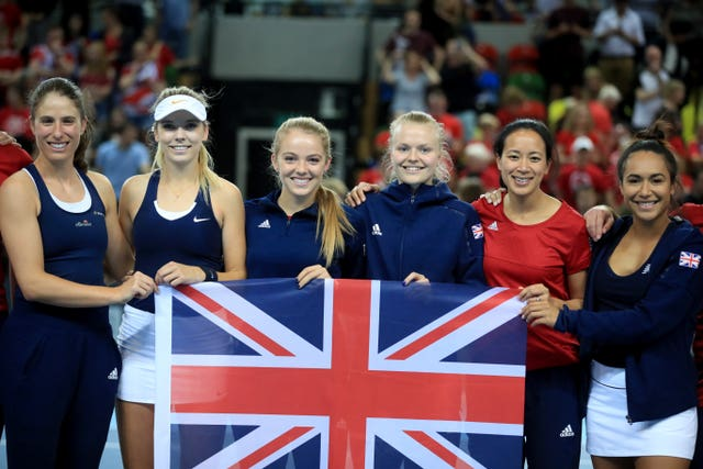 Anne Keothavong, second right, celebrates Fed Cup promotion with the Great Britain team