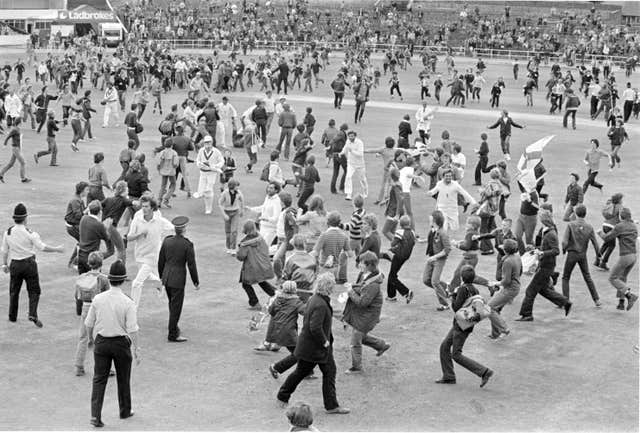 Bob Willis leads England off the Headingley pitch after their victory in 1981 as fans run on to celebrate