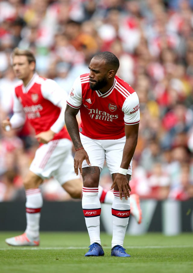 Alexandre Lacazette reacts after suffering an injury against Lyon