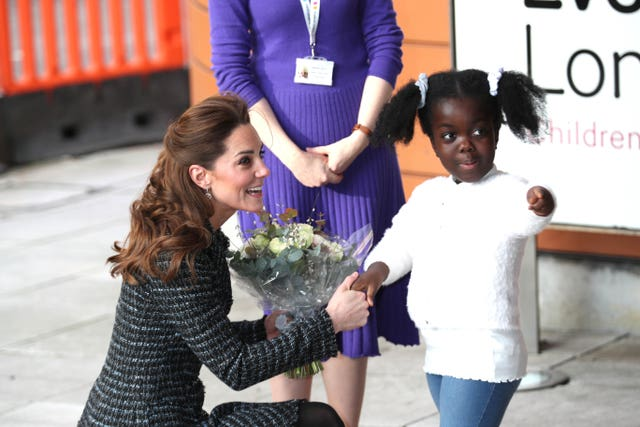 Kate is presented with flowers at the hospital