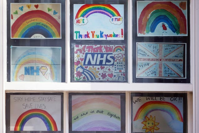 Pictures of rainbows with supportive messages for the NHS displayed in a window in Downing Street