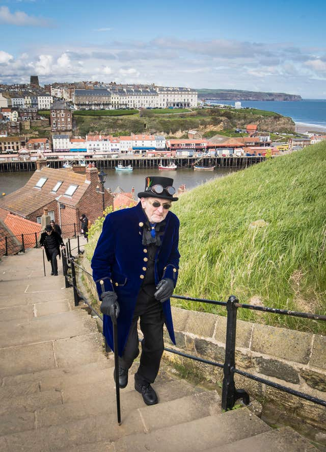 A man makes his way up Whitby's steps (Danny Lawson/PA)