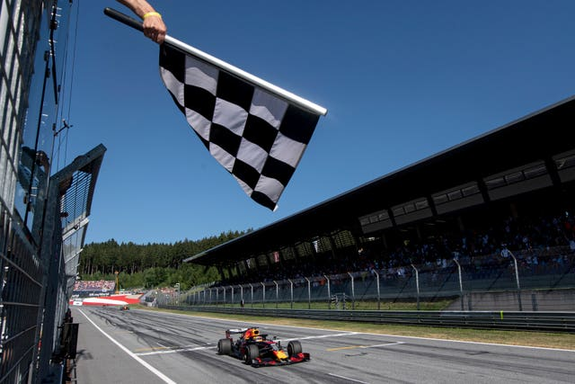 Max Verstappen crosses the finish line to win the Austrian Grand Prix