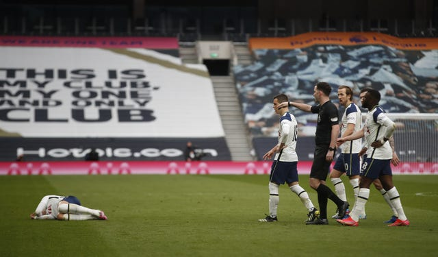 Son Heung-min, left, fell to the floor holding his face as United saw an opening goal disallowed