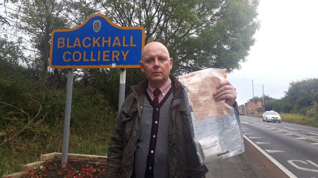 Detective Constable John Forster with one of the bundles