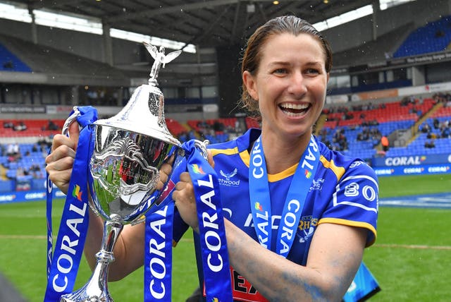 Leeds captain Courtney Hill celebrates with the Coral Women's Challenge Cup trophy