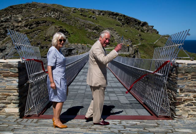 Charles cuts the ribbon to officially open the walkway. Geoff Caddick/PA Wire