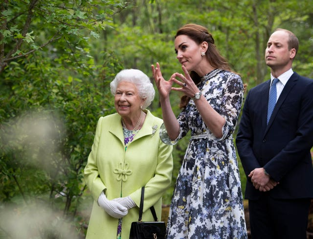 The Queen with the Duke and Duchess of Cambridge during their visit to the Chelsea Flower Show in 2019. Geoff Pugh/PA Wire