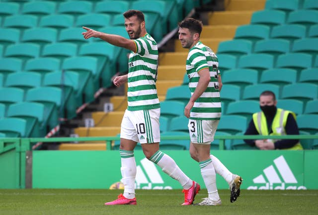 Celtic's Albian Ajeti (left) celebrates scoring his side's third goal