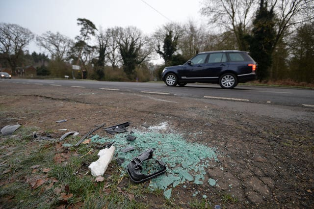 Broken glass and car parts on the side of the A149
