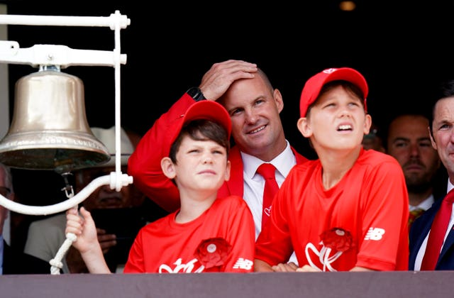 Sir Andrew Strauss (second right) with sons Luca and Sam before ringing the five-minutes-to-play bell at Lord's last summer