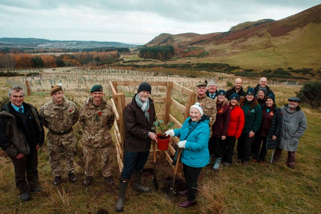 Planting a Verdun oak, descended from an acorn collected on the battlefield in France, at Scotland's First World War Centenary Wood at Dreghorn in Edinburgh