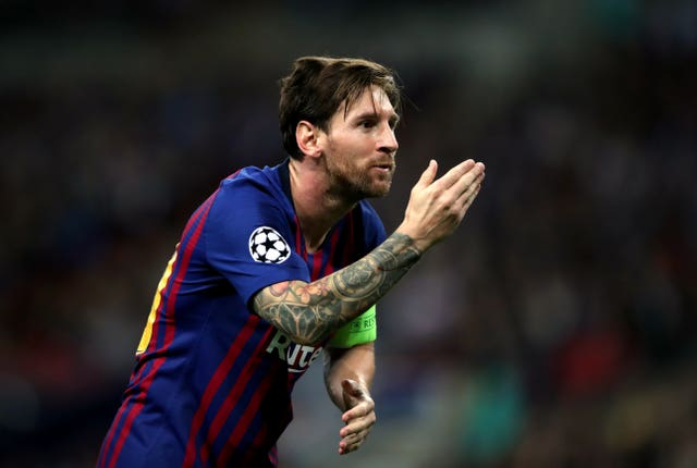 Barcelona's Lionel Messi celebrates scoring his first goal